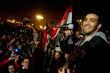 Egyptians celebrate in Cairo's Tahrir Square Friday, following the announcement that Hosni Mubarak will step down as president.  Ann Hermes / The Christian Science Monitor